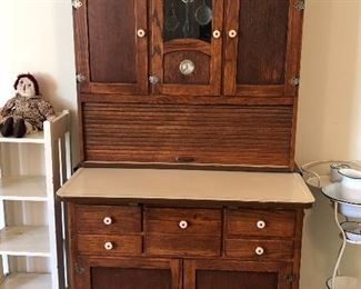 Unique antique Hoosier cupboard.  We can't find a brand name on this one!