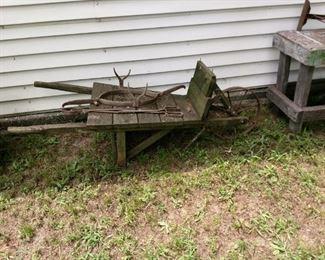 vintage wheelbarrow, primitive cattle head catcher