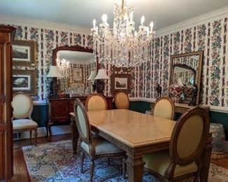 """Fugetabout the wallpaper, BUT the rest of the dining room is quite nice!                                                                         Large hand carved wood dining table, by Marge Carson, with six custom side chairs, Henredon buffet, set/4 nicely matted/framed hand-colored lithographs, vintage French walnut bonnetiere, measures 35""""W x 21 1/2""""D x 6' 3""""T and hand woven Persian rug, measuring 12' 2"""" x 8' 11""""."""