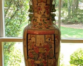 """One of a pair of 24"""" tall vintage Asian porcelain Familia Rose vases, on pickled wood stands."""