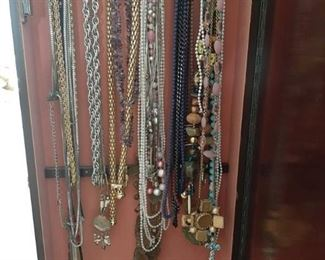 All Necklaces Hanging in Cabinet