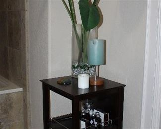 """Cappuccino Stand with 2 Pull-Out Gallery Shelves     (30""""H x 16"""" W x 15""""D).  Large Bird of Paradise Floral Arrangement in a 15"""" Square Glass Vase"""