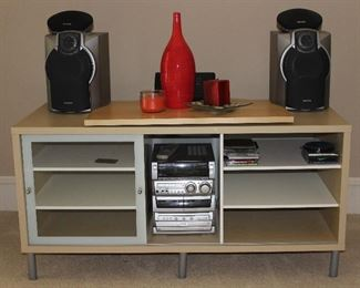 """IKEA Tv Stand, Blonde with Brushed Chrome Trim(51""""W x 25.5""""H  x23.5""""D).  Aiwa Audio Digital System CX-NMA845 3CD Changer AM/FM Digital Audio.  Compact Stereo System w/Speakers.  Also showing a Fitzgerald & Floyd Flame Red Bottle Vase (15""""H)"""
