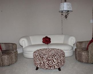 """Kidney Bean/Crescent Shape Boucle'  Vanilla Upholstery Sofa,  Dimensions Zebra Print 36"""" Round Ottoman and a Pair of Leopard Print Slope Back Swivel Barrel Chairs"""