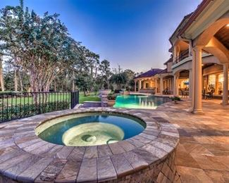 back view of home with spa/hot tub