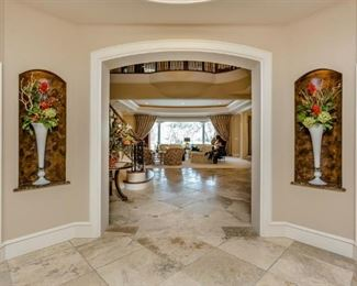 Entry View Entering Home Showing Tall White Blown Art Glass Trumpet Vases with Floral Arrangements.  (2 of 4 shown)