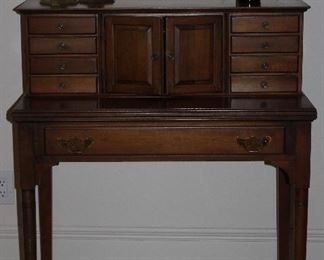 """2nd View: Vintage Spinet Desk with Drawers and Pockets on  Pad Feet (34""""W x 40""""H x 18'D), Vintage/Antique  Solid Brass 12"""" Bee Hive Candlesticks and Amber 1920's Lysol Bottle"""