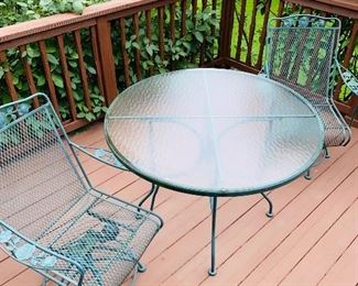 $125 GREEN WROUGHT IRON ROUND GLASS TOP PATIO TABLE WITH 2 CHAIRS