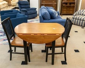 Adorable fold out table and two chairs.