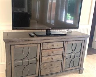 "55"" tv and 5' wide cabinet"