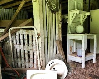 Sinks, lumber, creative furniture piece out of a door, all in the barn