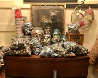 Marbles, marbles, marbles, coke cups, mid century chest, jars of old buttons and picture of a happy? couple!