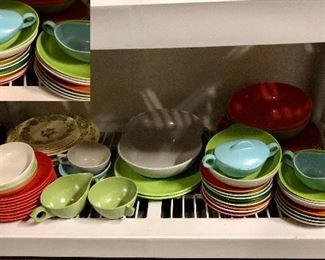 Shelf full of plastic dishes, look at those colors!