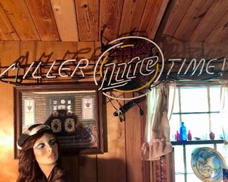 """MILLER TIME"" neon sign and vintage lady mannequin"