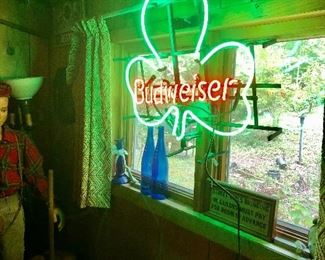Really cool Budweiser neon sign, also boy mannequin!
