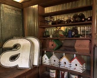 Big a's, log bird houses, wood shelves, all in the barn