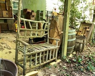 Twig settee, 2 barrels, on the back wall are lots of wooden crates