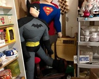 Life size Superman and Batman fighting for a seat on that rocker!