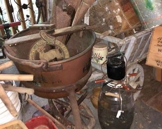 Look at the large copper pot with stand( can you say fudge?) mayonnaise jar with mixer, radio flyer wagon one of two, minnow bucket