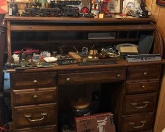 "Desk with lots of great small, vintage glasses, knives, cast iron train, Woody on his horse ,""Nothing says lovin"" sign"
