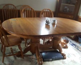 1. beautiful oak dining room table and 6 chairs. it has 2 leaves only one is in it now. $200