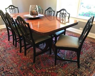 """Gorgeous dining room table with 10 chairs! Shown with one 12"""" leaf but includes 2 additional 12"""" leafs! Table measures 42""""deep x 66""""wide with NO leaf!"""