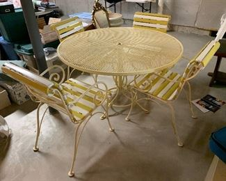 1. Retro Midcentury patio set with yellow and white straps.  You get table, 4 chairs and umbrella.   All stored inside and I would say extremely nice. Great clean condition.   $250