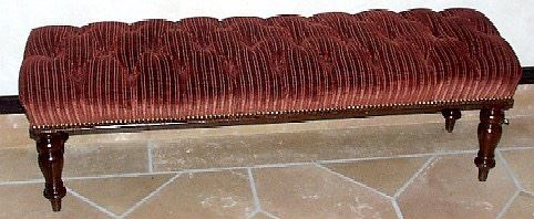 AN IRISH MAHOGANY HALL BENCH, CIRCA 1840 With corded red velour tufted upholstered cushion seat, on turned tapering legs 16 in. high; 52 in. wide; 14 in. deep