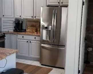 GE stainless steel refrigerator with French doors and beverage center; installed October 2013