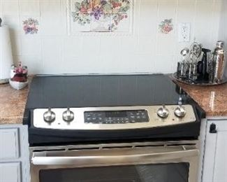 GE stainless steel range & microwave oven manufactured October 2013