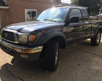 2002 Toyota Tacoma  xtra cab sr5 V6 5 speed manual trans Has 203k miles on it. Engine is said to have about 20k less miles on that as motor was replaced years ago with a motor from unit w lower miles. Timing chains were replaced less than 20k miles ago. Issues with transmission. I know the synchro going into 3rd gear is broken plus additional undiagnosed trans issues. Tires are pretty fresh with plenty or tread left. Shocks fresh but could be another suspension issue. 203k miles