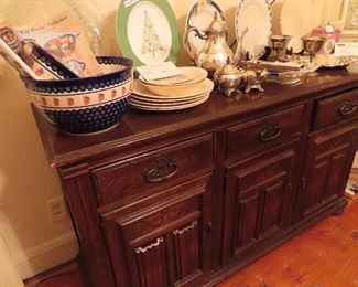 Buffet Ethan Allen Charter Oak Suite  3 drawers over 3 cabinets    You see 3 pieces Strawberry pattern  pottery, Poland  A Wedgwood Christmas Plate for  Emeril,  A vintage Magnolia Plate,  A Lenox china charger, Pieces of Antique English China, Silver bread tray, Antique Asparagus dish,   More