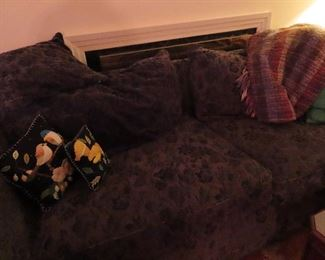The couch - dark damask slip covers over beige canvas upholstery.  Two casual pillows, appliqae flowers & birds.