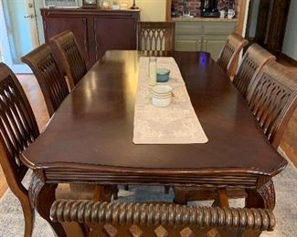 Gorgeous solid wood formal dinette with 2 leaves. 6 side chairs & 2 arm chairs. Leather cushions.  AVAILABLE FOR PRESALE, call for pricing