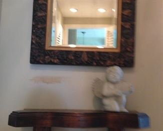 Carved mirror and shelf
