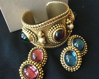 1980s Yves Saint Laurent / YSL Gold Tone Cuff Bracelet  & Earrings Signed and numbered, 10/500. You will receive the bracelet with 2 pairs of matching earrings. This is a stunning vintage set with beautiful details. Poured glass stones consisting of green, purple and blue along with 2 faux pearls. It comes in the Sakowitz box shown.
