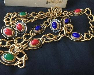 """Vintage Yves Saint Laurent / YSL Gold Necklace & Earrings Initial signature adhered inside loop of chain. You will receive the necklace with 2 pairs of matching earrings. Some wear on the edge of two of the oval pieces. The necklace measures approximately 37"""" in length. Glass stones consisting of green, red and blue are set inside black enamel. It comes in the Neiman Marcus box shown."""