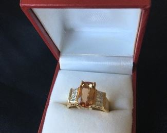 18k Topaz ring with diamonds 4-25 pt Princess cut diamonds. Two on each side. Sized to a 7.