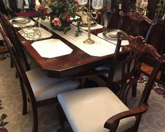 Beautiful dining room table with 2 leaves, 8 chairs, and table pads for protection