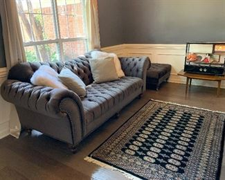 """#1Aira Designs sofa 97"""" $200.00  #2Aira Designs ottoman 48""""x32""""x19"""" $100.00  #5Wooden mid century coffee table 39""""x31""""x16"""" As is top condition $75.00  #13Asian display cabinet with 2 drawers, music box and 2 dolls 29'x10""""x25"""" $75.00  Rug not for sale."""