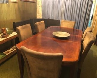 Dining room table. Seats 6. Small corner nook with bench.