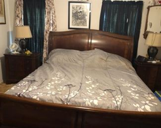 Primary bedroom furniture. King size sleigh bed with matching chest of drawers, dresser with mirror and two night stands.