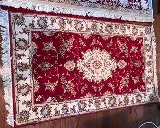 """Small wool red carpet in excellent condition - 48""""x28.5"""" Price $250"""