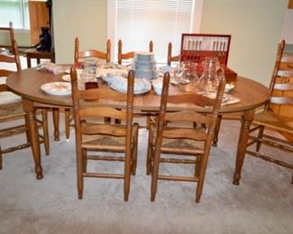 oak dining room table with 6 chairs and a spare!