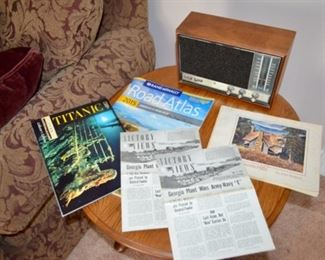 """FM radio; Titanic picture book; 1943 """"Victory News"""" from the LeTourneau Co. of Georgia; book by John Kollock"""