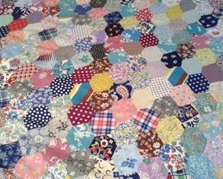unfinished quilt top of many vintage pieces