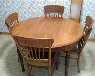 vintage solid wood table and four chairs