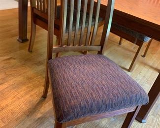 Chairs have padded seats