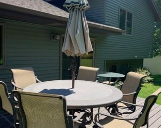 Nice patio set with 6 chairs and umbrella