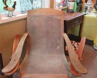 antique plantation teak and cane lounge chair.
